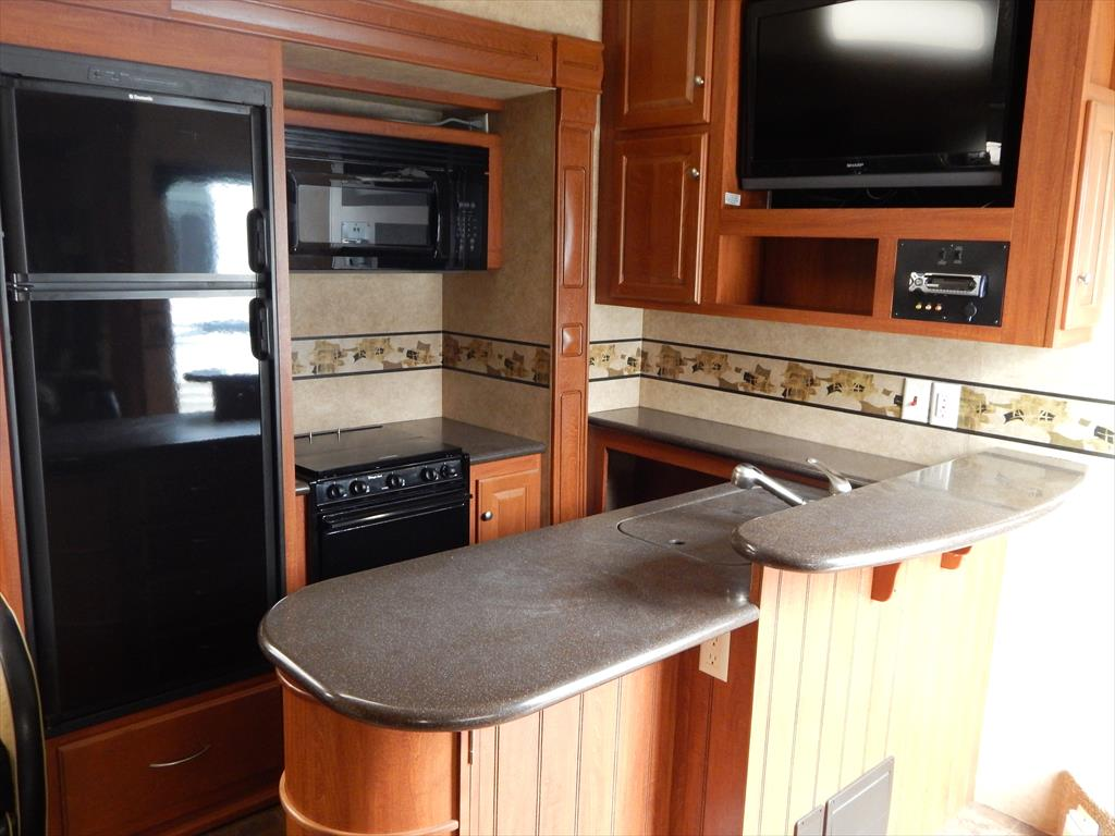 2011 heartland rv cyclone 3950 triple slideout w 12 for Kitchen cabinets 08094
